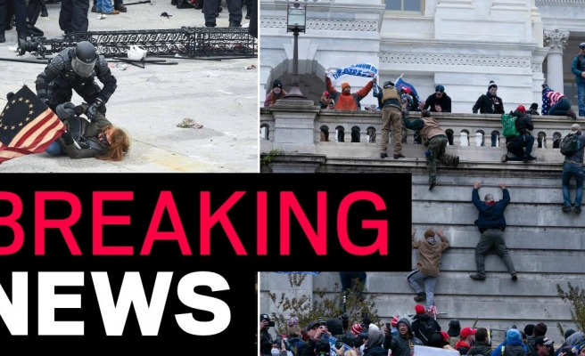 Police arrest 68 after Capitol building riots as Army plans to build wall around it